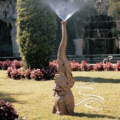 Design Toscano Tiny the Elephant Lawn Sculpture and Garden Sprinkler. how cool is this? i love it.