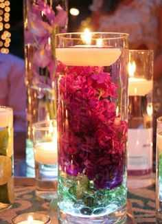 Centerpieces on a budget: you can get the vases and rocks at Dollar Tree and the floating candles in a 6 pack at Hobby Lobby. Add fabric flowers in the colors of the wedding for a very pretty, very thrifty centerpiece. Wedding Events, Wedding Reception, Our Wedding, Dream Wedding, Weddings, Reception Table, Wedding Stuff, Camo Wedding, Yellow Wedding