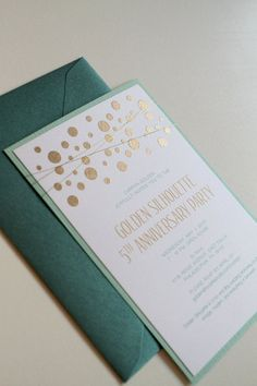 So pretty! Gold embossed polka dot invitations with mint envelope