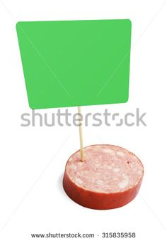 Piece of a smoked sausage with green blank cardboard information tag, isolated on white