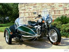 British Racing Green Triumph Thunderbird and sidecar (looks like a Watsonian)