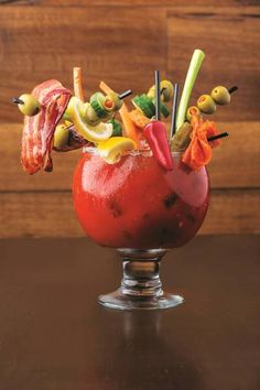 Bloody Mary at GuyFieri's restaurant in Vegas. We can do this!!I can see brett getting this, I call the hot peppers and bacon!