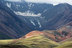 Mountains, clouds, ice, and tundra.  View in Denali National Park, Alaska, USA