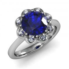 Blue Sapphire & Diamond Scrolled Detailed Ring set in 18K White Gold. (8mm)
