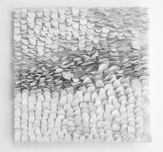 paper art installation , texture and shade created from simple shapes and cutting and folding