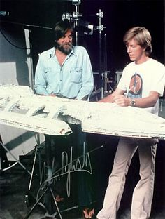 Special effects master John Dykstra and an unknown man in a Star Wars t-shirt, with the filming miniature of the Battlestar Galactica, circa 1978 Kampfstern Galactica, Best Sci Fi Shows, Battlestar Galactica 1978, Pintura Exterior, Sci Fi Models, Star Wars Models, Sci Fi Ships, Por Tv, Movie Props
