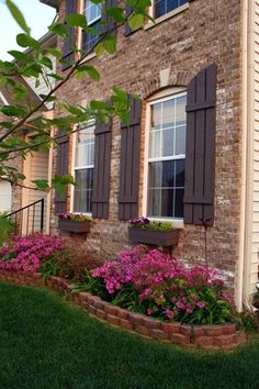 I've always loved the idea of outdoor window & flower boxes. So pretty & I bet they smell so good.