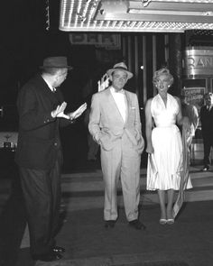 """Marilyn and Tom Ewell speak with Billy Wilder in front of the theatre. """"The Seven Year Itch"""" 1954"""