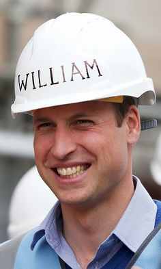 Prince William, Duke of Cambridge looks on as he helps to renovate homes for ex-service personnel as part of the BBC television DIY SOS series on September 23, 2015 in Manchester, England.