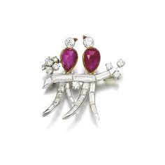 Ruby and diamond brooch, circa 1950 Depicting a pair of birds perched on a branch, set with inverted pear-shaped rubies and baguette and brilliant-cut diamonds, numbered, fitted case.