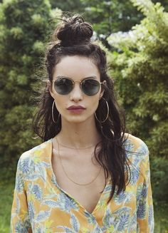 Half up half down hairstyle.  Updos for half buns with messy beachy locks.