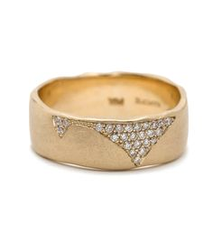 This 7mm torn paper edge band defines subtle luxury. A softly textured gold band is cracked and pave set with diamonds. Simply stunning!This piece is part of our Clean Slate Edit. See the entire collection here.