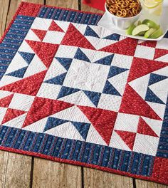 What a pretty table topper! Make this patriotic piece using simple units such as Flying Geese and Triangle-Squares. It's a one-block wonder you can whip up in no time. About This Quilt Finished Size: 28″ x 28″ Rating: Easy Designed by: Colleen Tauke Recommended Tools: Fons & Porter Rotary Cutter, Olfa 12″ Spinning Cutting Mat,…