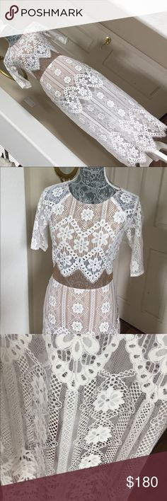 """For Love & Lemon White Floral-lace Dress NWT New with tag. Got from another posher and I really love it but it doesn't fit me so letting it go. Total length is approx 43"""". There's tan lining on the top part and also a short bodysuit-like on the bottom so you don't have to worry about wearing another piece under. Absolutely beautiful and adoring. Sweet floral lace in white For Love and Lemons Dresses"""