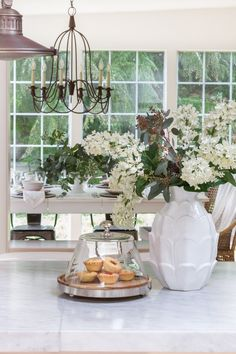 A farmhouse/cottage style home tour sharing tips for decorating during the spring season. Easy and simple ways to dress your home up with pops of color.