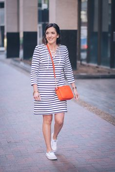 Jo-Lynne Shane wearing Old Navy Lace-Up Yoke Shift Dress in Navy Stripe with Converse Shoreline and Tory Burch Ivy Crossbody in Samba Red #springfashion