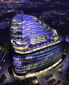 External night photo of The Co-operative Headquarters in Manchester built by BAM. The building achieved a BREEAM Outstanding rating with the highest score ever attained.