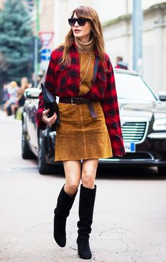 Ece Sukan wears a turtleneck, suede dress, belted plaid flannel shirt, and knee-high suede boots