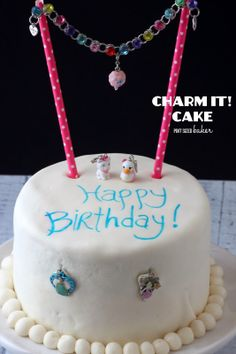 """It's a """"Charmed"""" Birthday cake! An easy Birthday Cake adorned with a CHARM IT!  bracelet and charms. @pintsizedbaker @rachel IT!"""