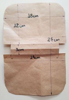 Acompanhe o passo à passo de como fazer uma carteira de patchwork com laço de tecido.