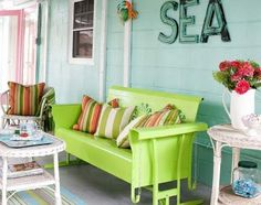 I would wreck my car if I drove by and saw this awesome green glider on someone's porch!