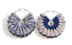 Earrings | Liron Braker.  Leather, silver, zircon.