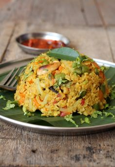 Oats Upma laden with vegetables that your kids will love.