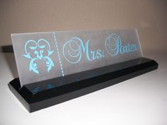 Office Desk Name Plate: Personalized Professional Wood Sign Gift 10 x 2.5. $19.99, via Etsy.