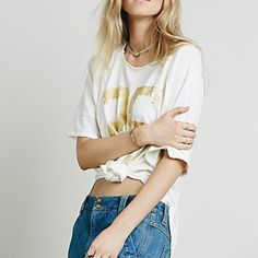 **FOUND** FREE PEOPLE TAILGATE TEE FOOTBALL JERSEY I'm in search of this Free People Tailgate tee in white or purple in a medium or a large!  Tag me please! Free People Tops Tees - Short Sleeve