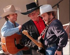 Dwight Yoakam, left, and fellow country music legends Buck Owens, center, and Merle Haggard defined what became known as the Bakersfield Sound.