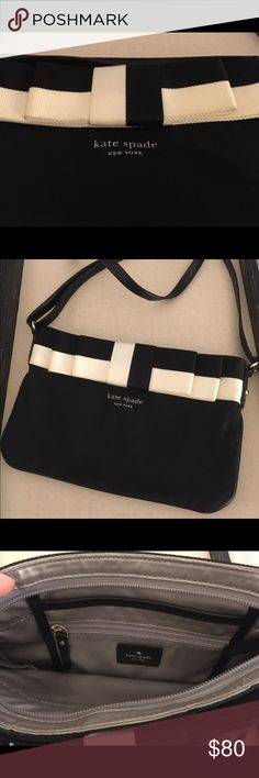 """FLASH SALE!! Kate Spade Cross Body Gently loved black and cream Kate Spade Bag. Material: Leather strap & trim/ Nylon. Silver material inside. Dimensions: 10""""W x 6.5""""L Bag expands .5"""" to 2"""" You can surprisingly fit a lot in the bag! Shoulder Strap 22"""" (can lengthen to 33"""") kate spade Bags Crossbody Bags"""