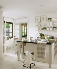 A wee eclectic kitchen in white................