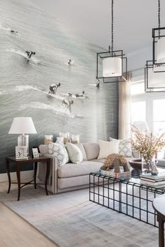 A beach-worthy accent wall makes a stylish statement and focal point in the living room, which serves as the central gathering space in the home.