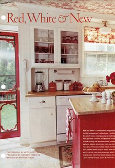 Red toile kitchen. I love the wallpaper on the ceiling. I wouldn't want to hang it mind you but I love it. And the red accents and door just make everything pop! I really like the glass front cupboards.