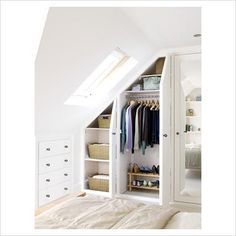 Built in wardrobe and chest of drawers in an attic room to make the best use of ...