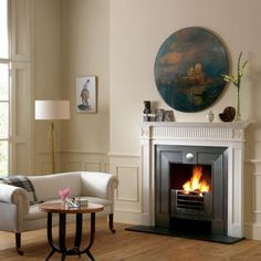 A classic composition of perfect proportions, carved in statuary marble Fireplace.