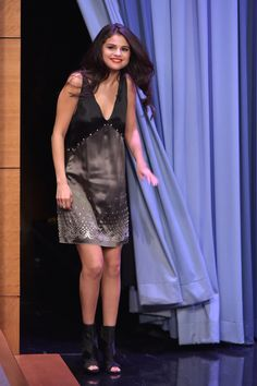 In a black and metallic satin dress and Giuseppe Zanotti Design booties on The Tonight Show with Jimmy Fallon.     - HarpersBAZAAR.com