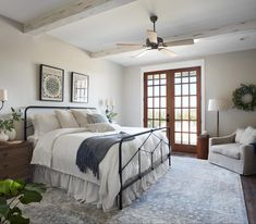 Season 5 To keep this master suite feeling peaceful and relaxing, I went with soft, neutral walls, whitewashed beams on the ceiling, and medium stained wood doors.Season One Season One may refer to: . Fixer Upper Dekoration, Estilo Joanna Gaines, Fixer Upper Bedrooms, Fixer Upper Living Room, Decoration Ikea, Farmhouse Master Bedroom, Master Bedrooms, Guest Bedrooms, Bedroom With French Doors