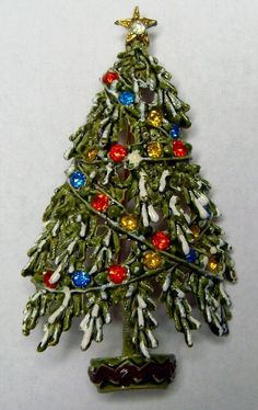 How I wish I had taken better care of the various Christmas tree pins I have had over the years. As costume jewelry, they are often taken for granted. But bringing a collection of pins to a Pinterest board highlights how special they can be.