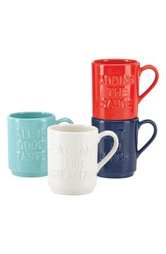 Clever culinary quotes add signature charm to this set of glazed ceramic mugs by Kate Spade.