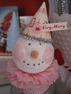 She has an awesome tutorial on making this cute snowman candy container.