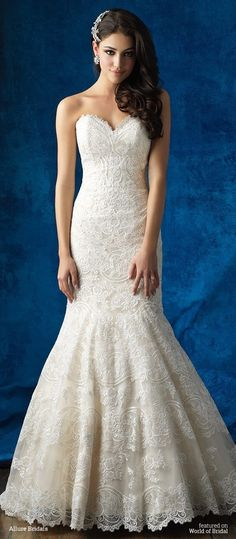 Textured lace appliques elevate this strapless gown into a thing of beauty.