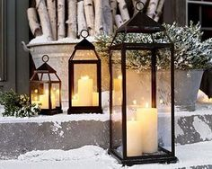 instead of glass hurricanes, use lanterns outside in the snow.