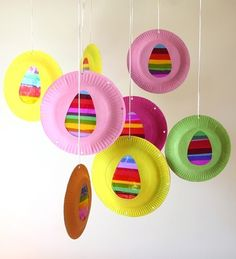 """Hang these beautiful """"stained glass"""" Easter eggs in a window so the sun can shine through to make them sparkle.  The original webpage (Jellyfish Jelly) for this project is no longer available but it's really just a matter of cutting out an egg shape and then taping or gluing (at the edges) strips of cellophane paper to the back"""
