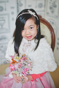 Real Wedding: Ariane and Andy's Afternoon Tea-Themed Wedding in New Zealand - Flower Girl with beautiful butterfly bouquet