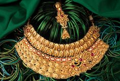 Gold and Diamond jewellery designs: tbz wedding collection