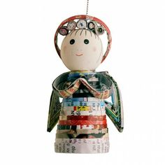 Ten Thousand Villages: Recycled Magazine Angel Ornament.  This fun ornament is made from recycled magazines by fair trade artisans in Vietnam: $10.00