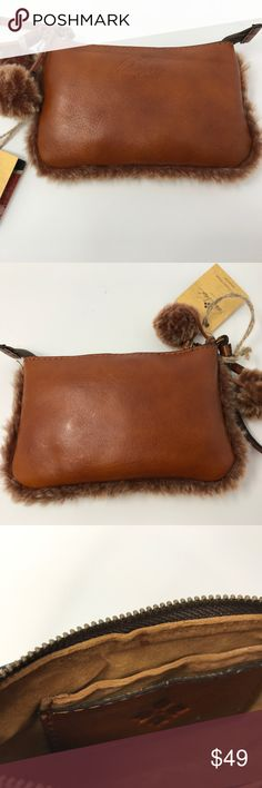 """NWT Patricia Nash Leather Sherpa Wristlet New, NWT PATRICIA NASH DESIGNS ITALIAN LEATHER VINOVO LASER CUT PIEDMONT SHERPA WRISTLET WALLET in TAN!  PRODUCT DETAILS      100% Italian Leather trimmed with laser cut Sherpa     Leather Wristlet Strap     Zippered closure for easy access     Fully Lined     Four Card Slots     Hanging Sherpa Pompoms     Registration Card Included     4""""H x 1""""W x 7""""L Approximate Dimensions Patricia Nash Bags Clutches & Wristlets"""