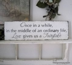 Once in a while in the middle of an ordinary life Love gives us a Fairytale / Vintage Wedding Sign 7 x 24. $44.95, via Etsy.