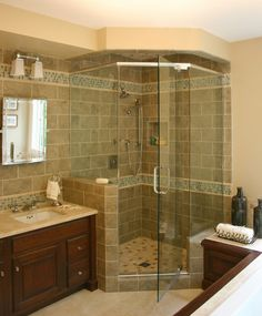 Glass shower with a beautiful natural tile wall#Shower #Bathroom #Home #Awesome